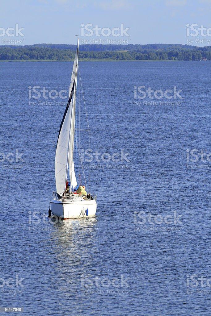 Lake and sailboat stock photo