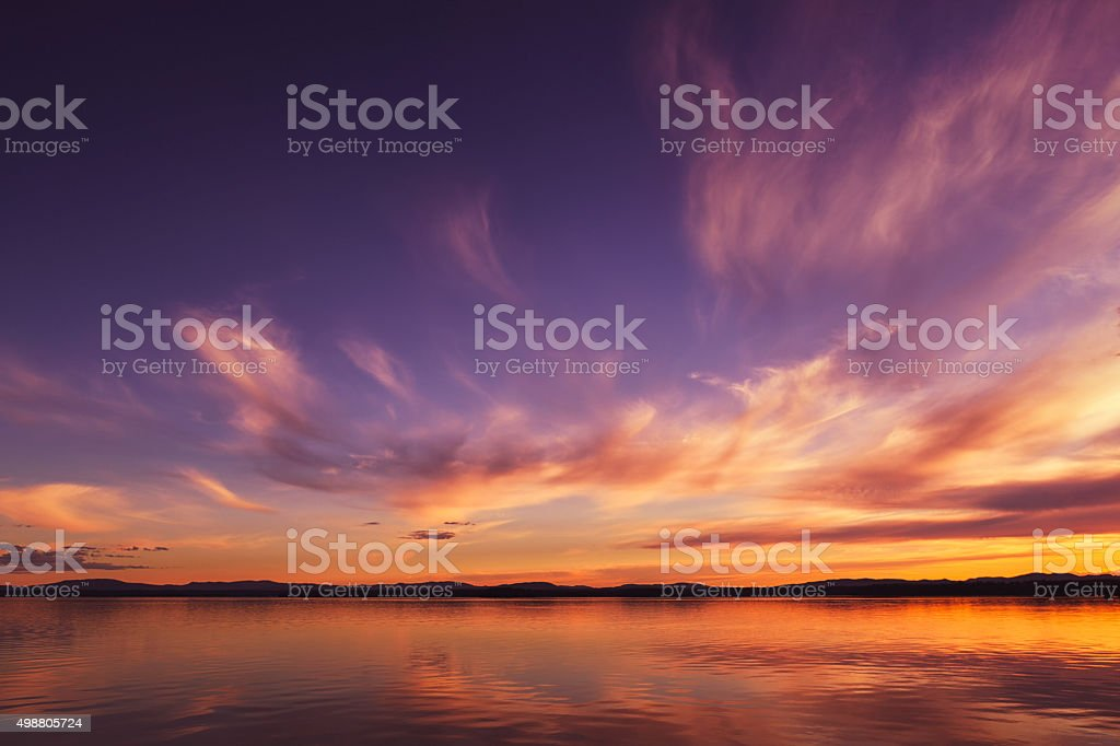 Lake and sky at sunset stock photo