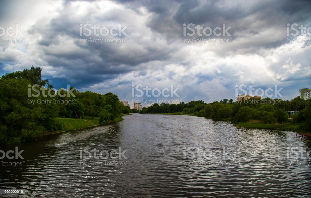 Lake and storm clouds stock photo