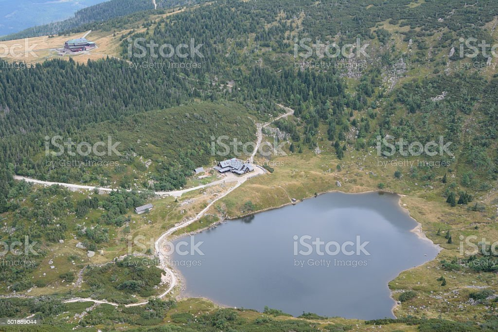 Lake and two mountain hostels. stock photo