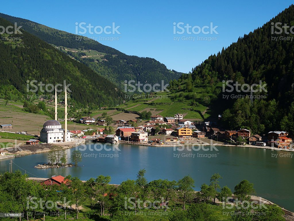 Lake and vivid green mountains in Mosque stock photo