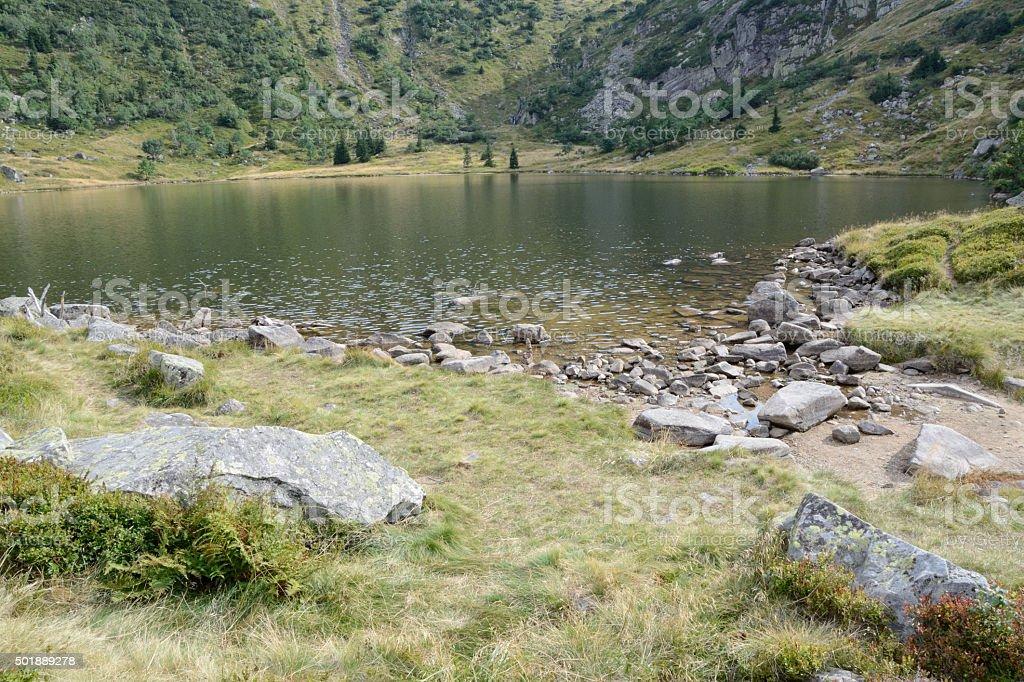 Lake at Samotnia mountain hostel in Karkonosze mountains. stock photo