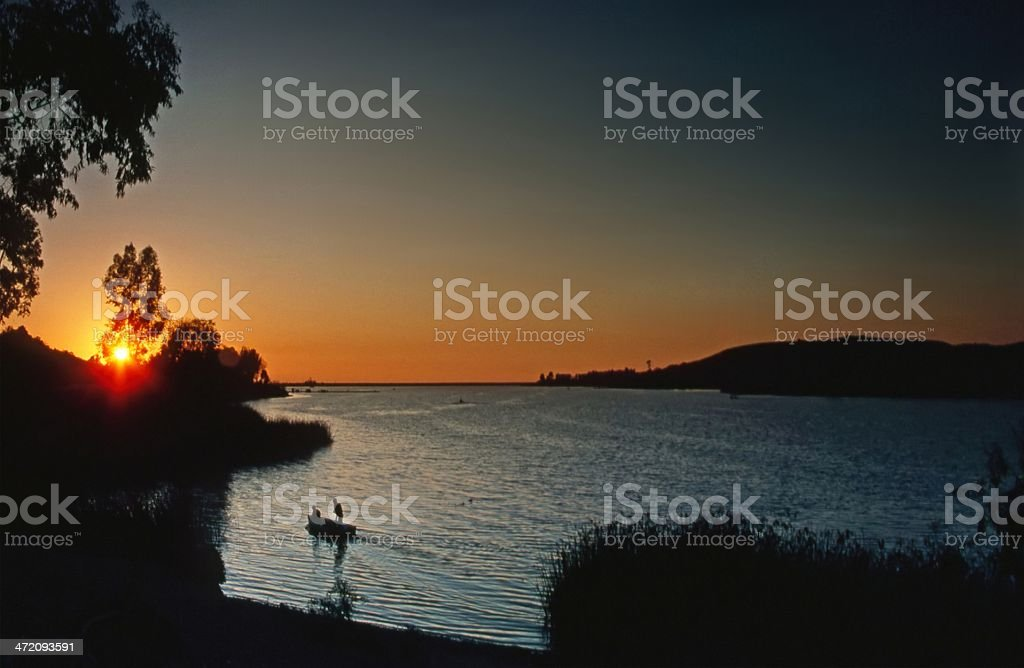 Lake at sunset stock photo