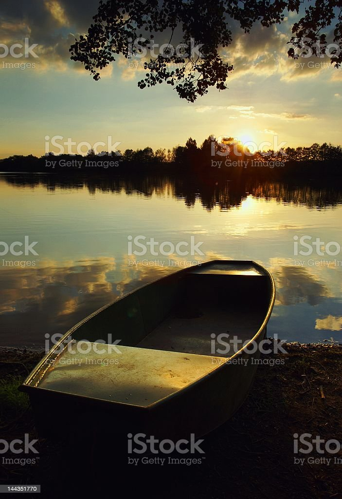 Lake at Sunset with a Boat royalty-free stock photo