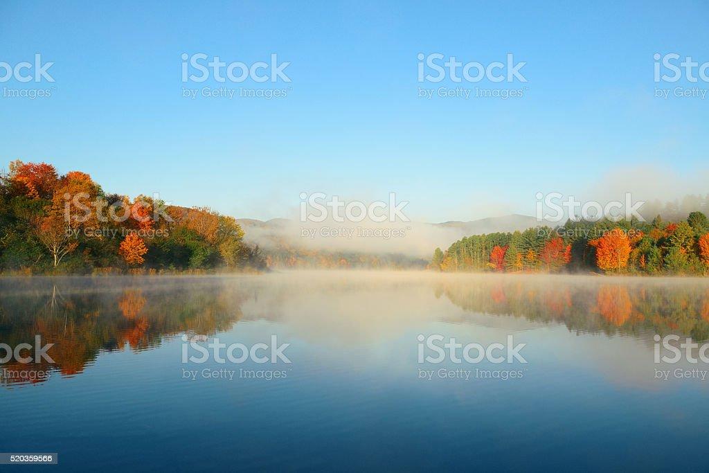 Lake Autumn Foliage fog stock photo