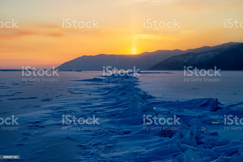 Lake Baikal in winter at sunset. Ice hummocks stock photo
