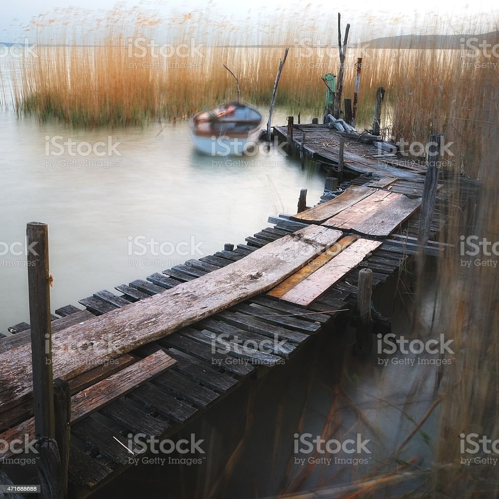 Lake Balaton pier with boat stock photo