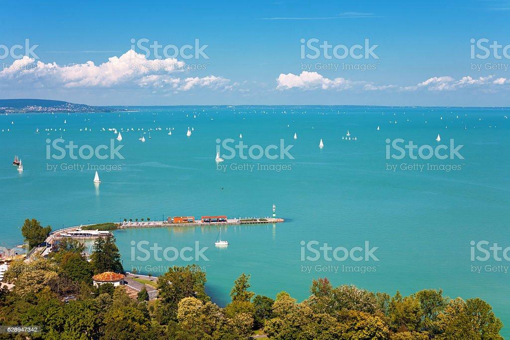 Lake Balaton with lots of sailboats from Tihany village stock photo