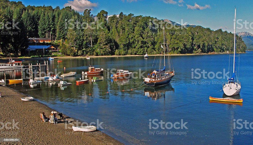 lake beach and sailboats stock photo