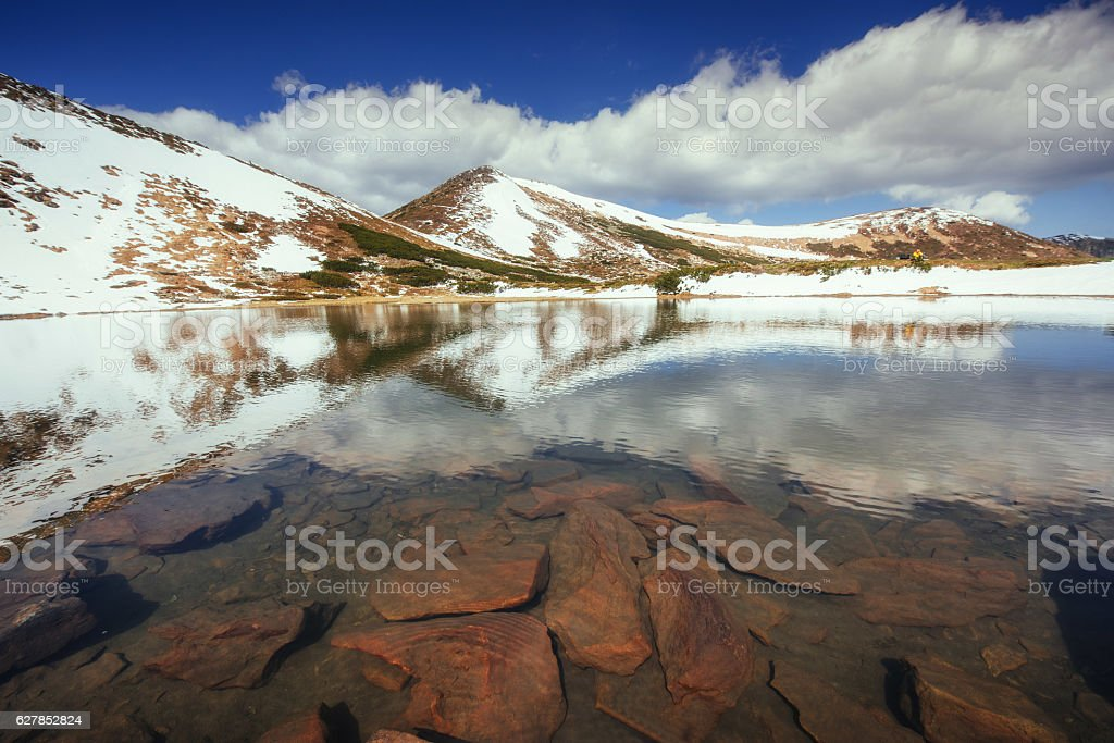 Lake between mountains. Spring landscape. Carpathians. Ukraine. stock photo
