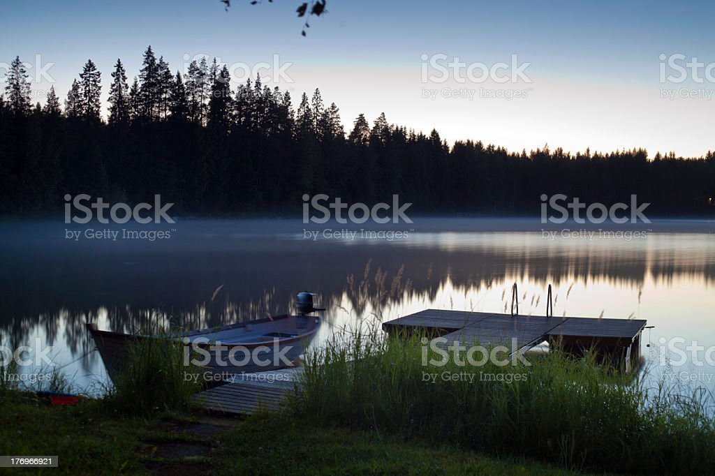 Lake, boat, jetty and reed royalty-free stock photo