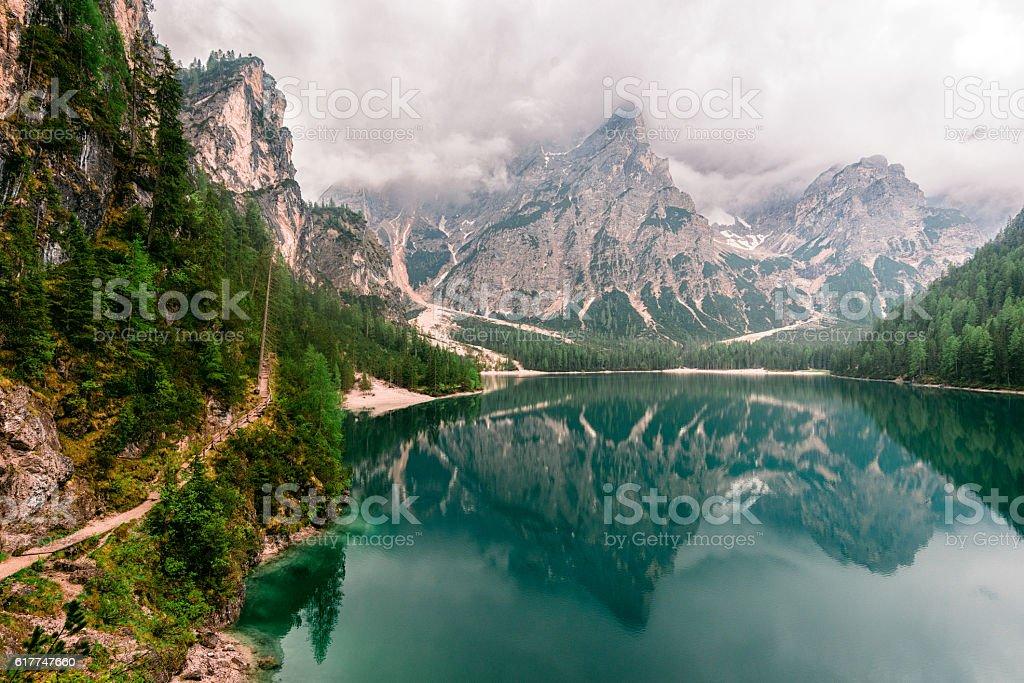 Lake Braies hiking trail in Dolomites mountains stock photo
