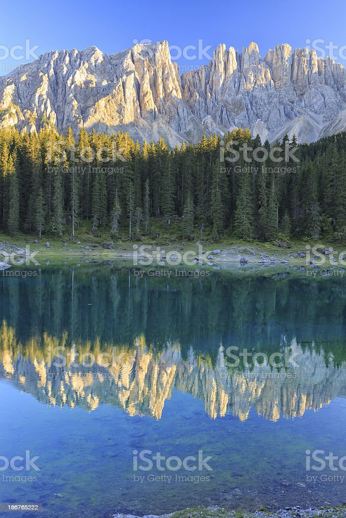 Lake Carezza and Latemar mountain range royalty-free stock photo