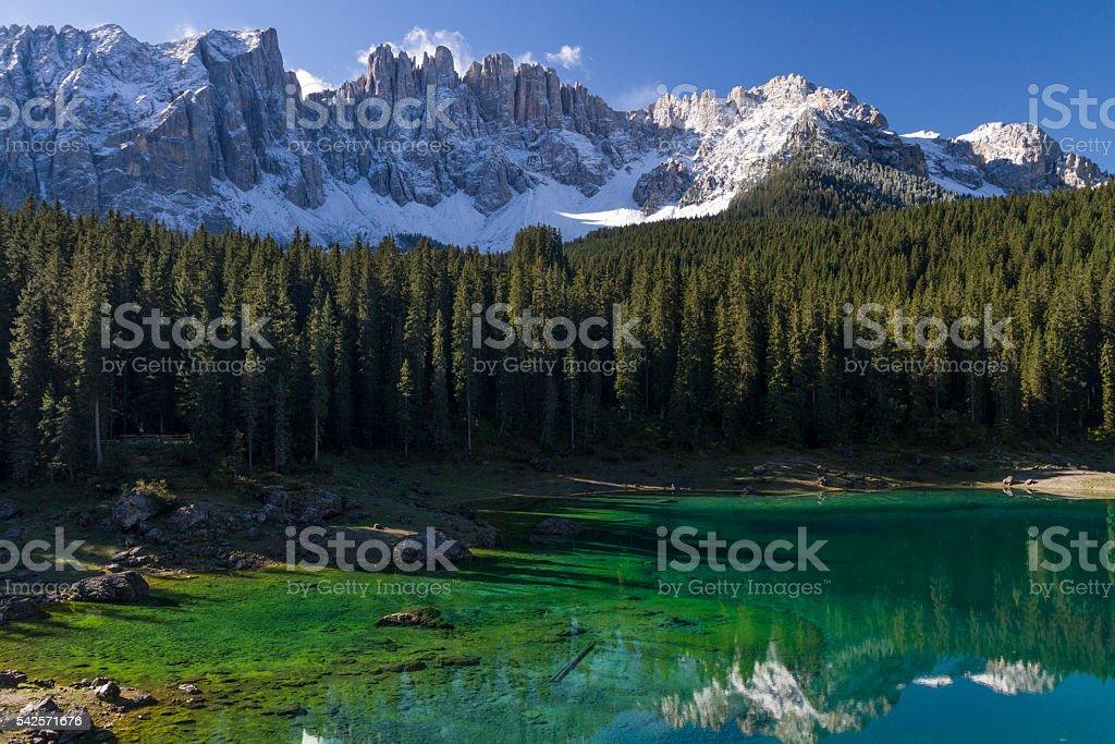 Lake Carezza with Latemar Mountains stock photo