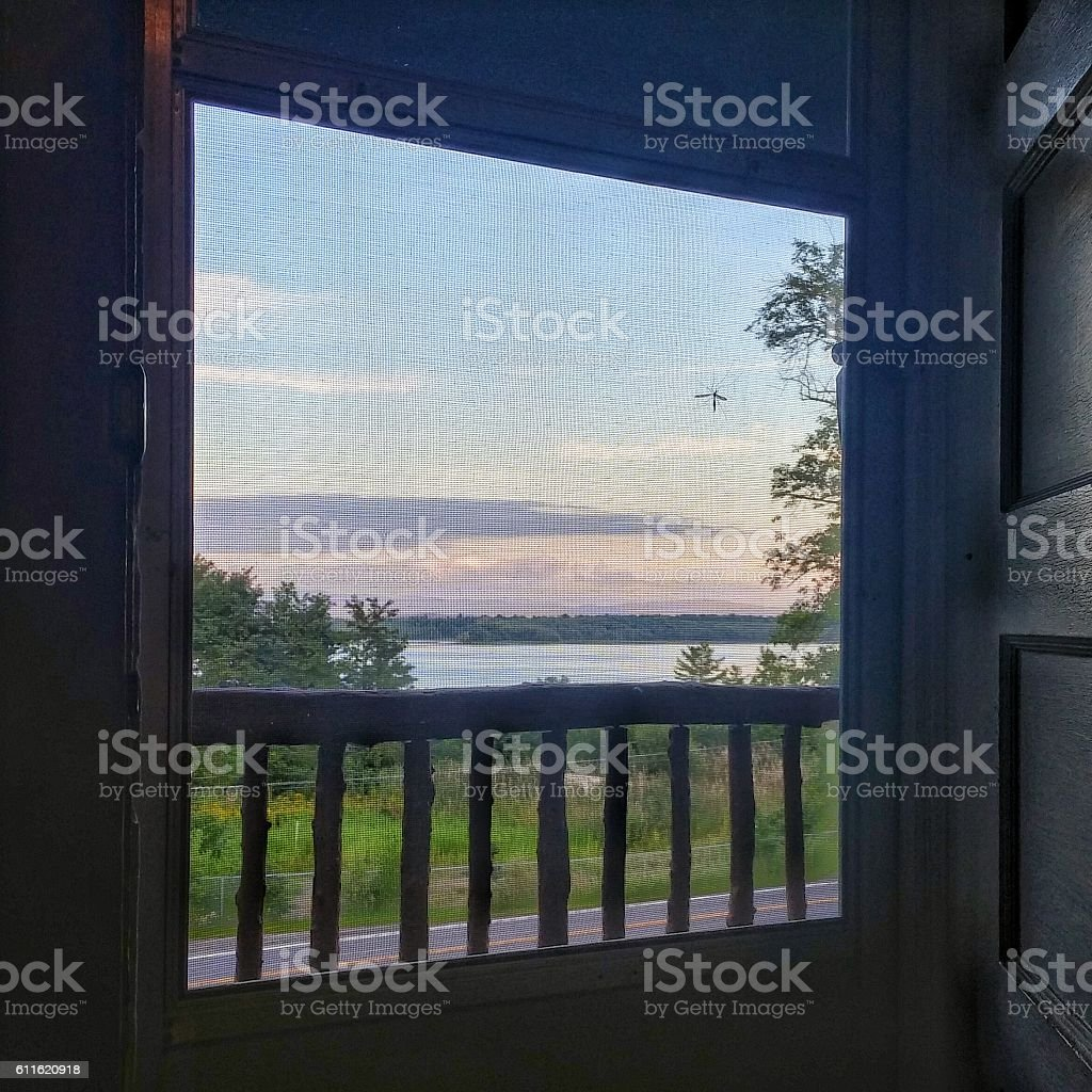 Lake Champlain Adirondack Rustic Porch Rail Screen Door Open View stock photo