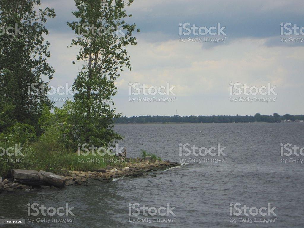 Lake Champlain, Plattsburgh, New York, Land, water and trees stock photo
