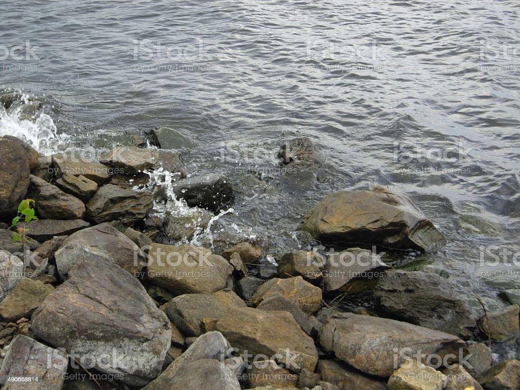 Lake Champlain, Plattsburgh, New York rocky lake shore stock photo
