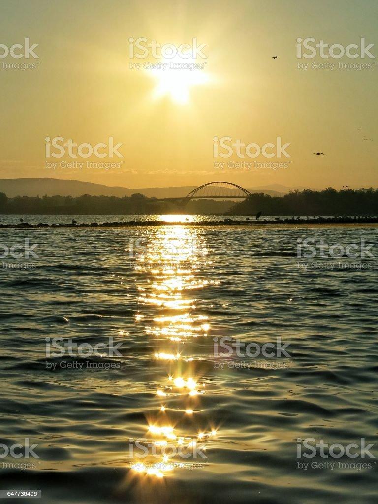 Lake Champlain Ticonderoga Bridge Sunrise Twinkling Star Water Reflection stock photo