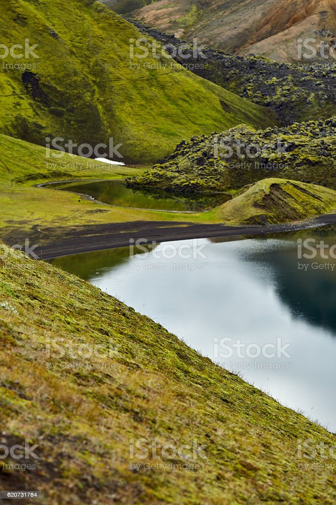 Lake coast with mountain reflection, Iceland stock photo