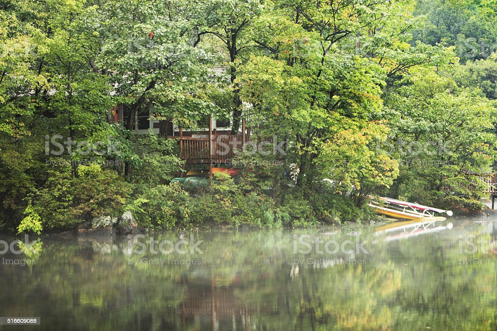Lake Cottage Mist Hidden Forest Cabin stock photo