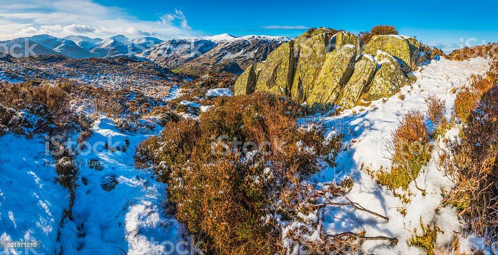 Lake District golden heather crisp white snow mountain fells panorama stock photo