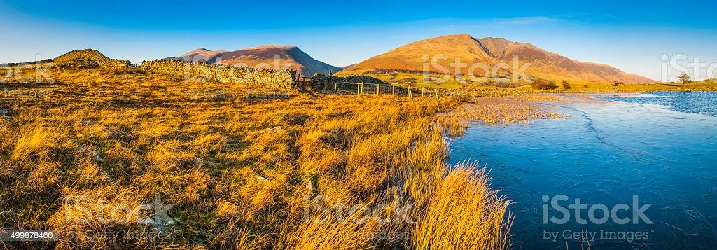 Lake District golden light on Blencathra dry stone wall Cumbria stock photo