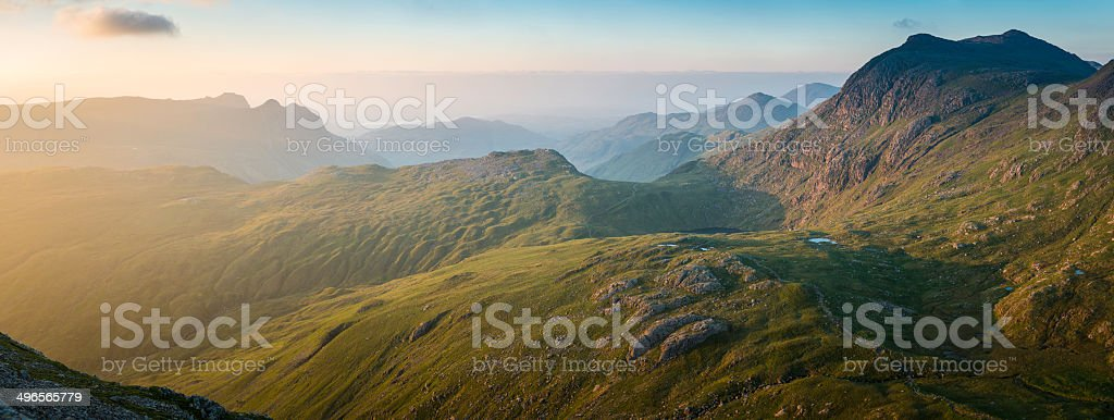 Lake District mountain sunrise panorama Langdale Pikes Bow Fell Cumbria stock photo