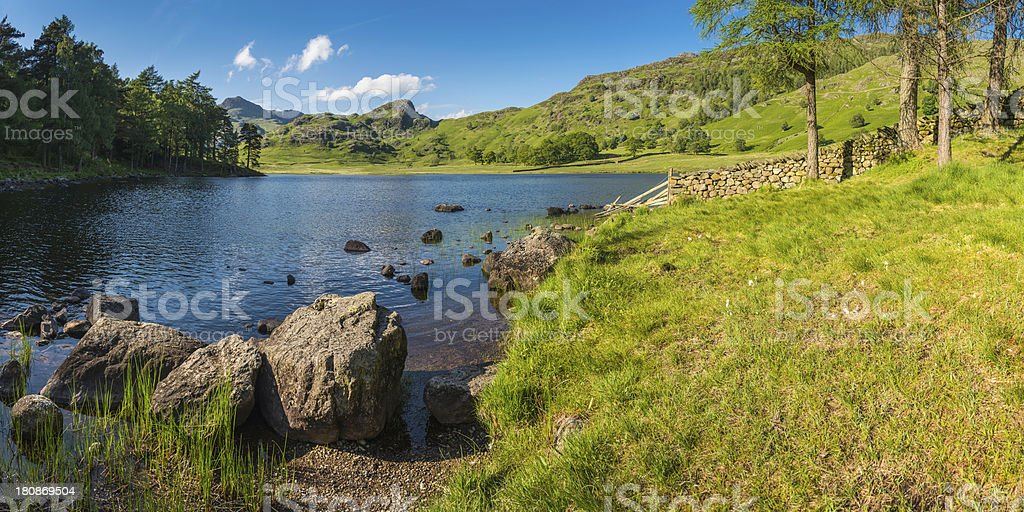 Lake District summer meadows green mountains peaks panorama Cumbria UK royalty-free stock photo