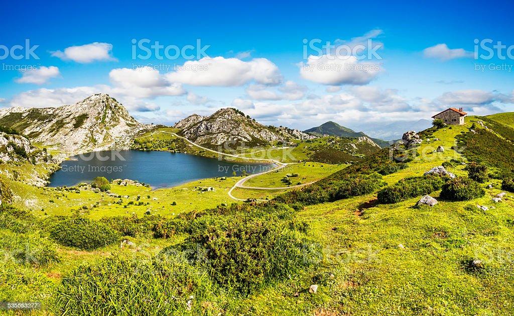 Lake Enol and mountain retreat, Asturias, Spain. stock photo