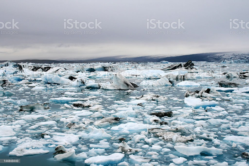 Lake filled with turquoise ice stock photo