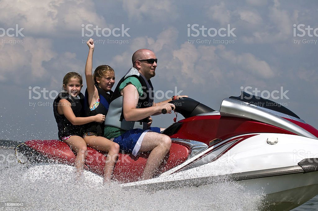 Lake fun on personal watercraft royalty-free stock photo
