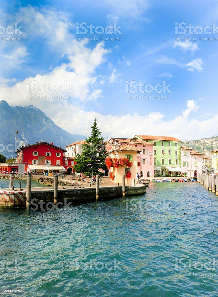 Torbole, Italy - September 21, 2014: Lake Garda boardwalk with stock photo