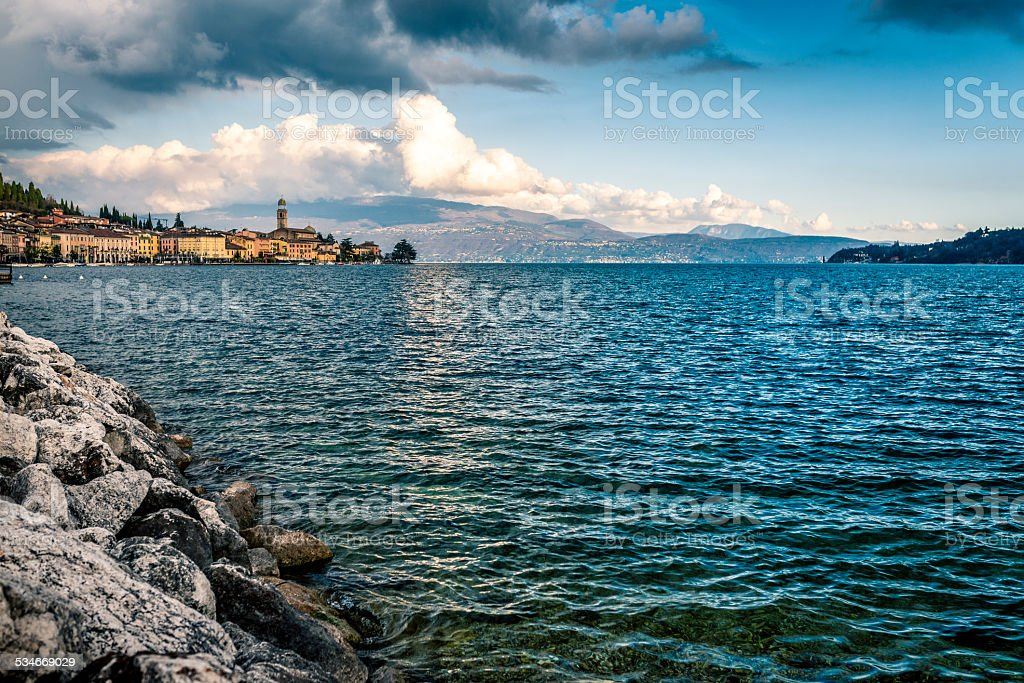 lake Garda under cloudy sky stock photo