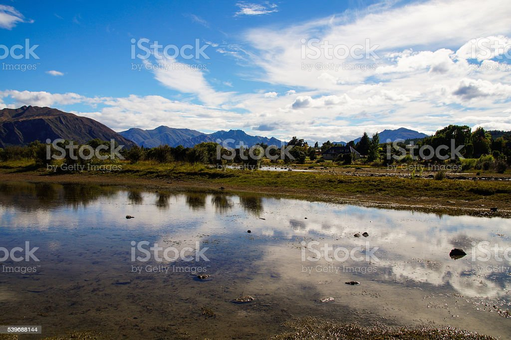 Lake Hayes is located between Queenstown and Arrowtown, New Zealand stock photo