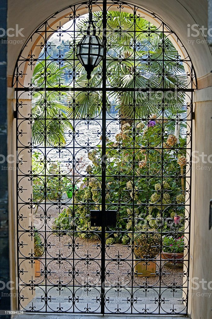 lake house idyllic view inside, looking out of the gate royalty-free stock photo