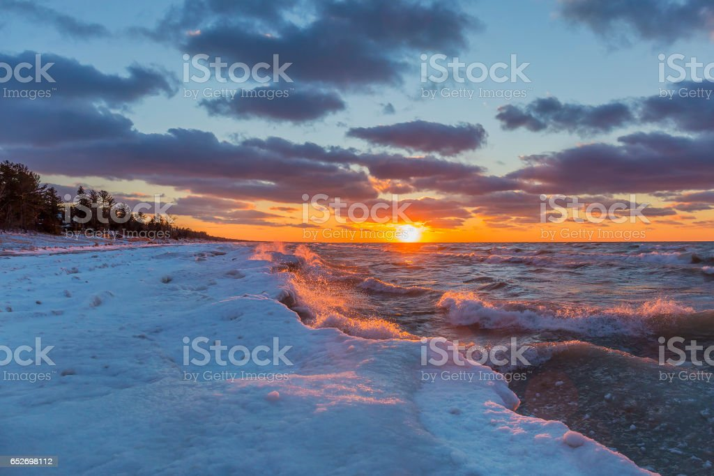 Lake Huron Shoreline in Winter at Sunset stock photo