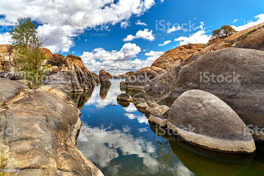 Lake in Boulders showing Water Line in Rocks stock photo