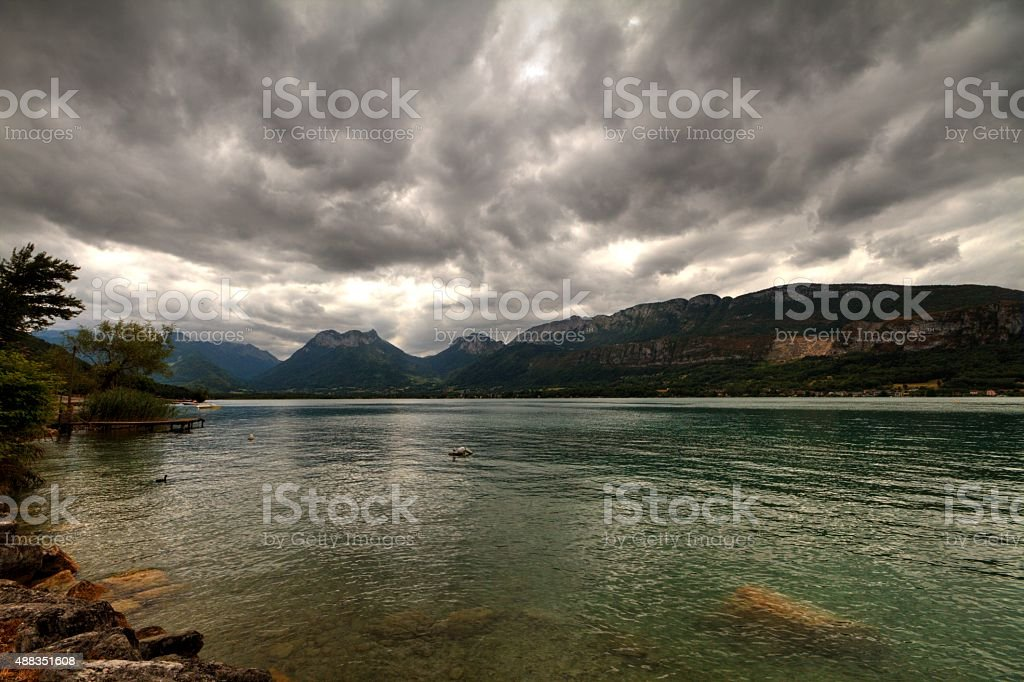 lake in French alps on overcast day stock photo