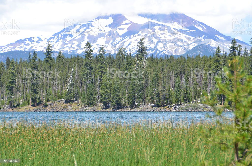 Lake in front of a snow-capped mountain in Oregon stock photo