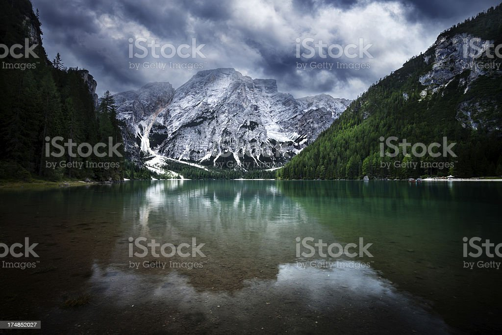 Lake in mountains. Overcast sky over Dolomites Alps. royalty-free stock photo