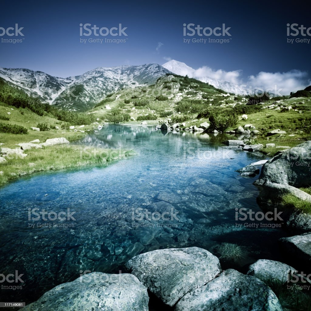 Lake in mountains stock photo