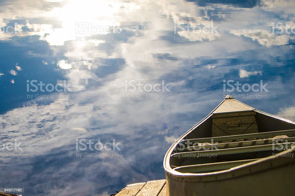lake in new hampshire with boat stock photo