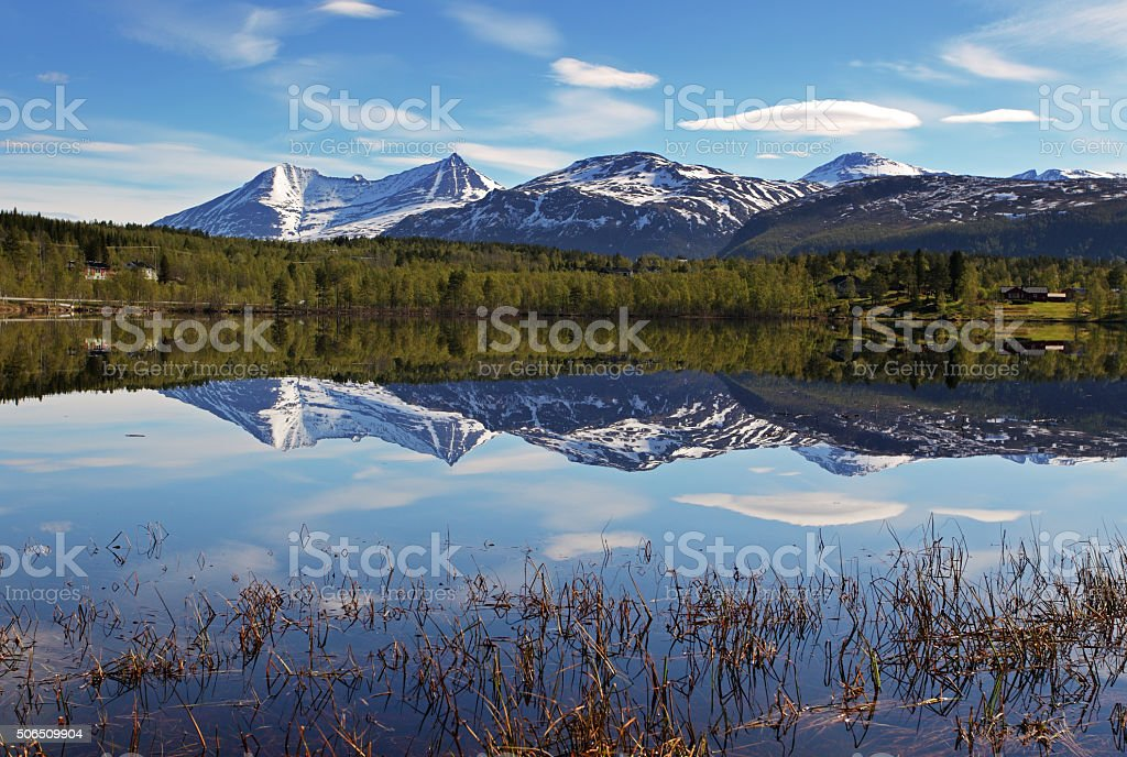 Lake in Norway with snowcapped mountain stock photo