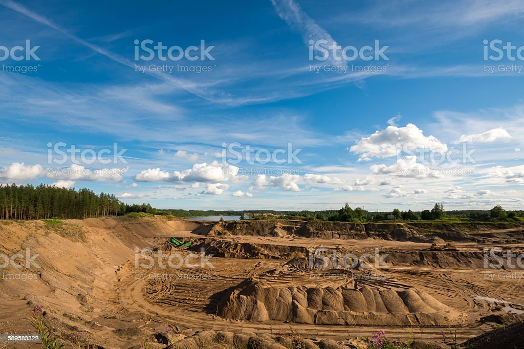 Lake in quarry. Blue sky with clouds. stock photo