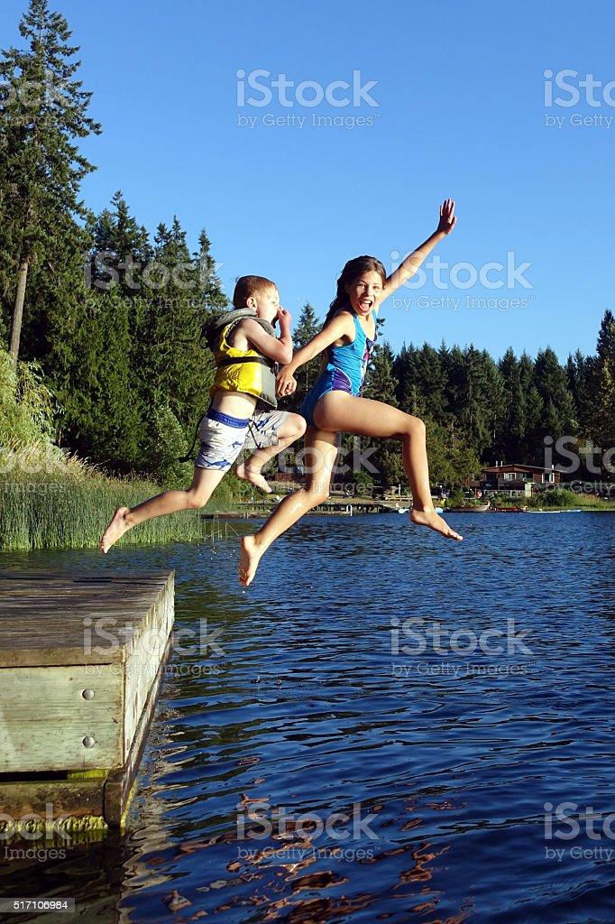lake jumping stock photo