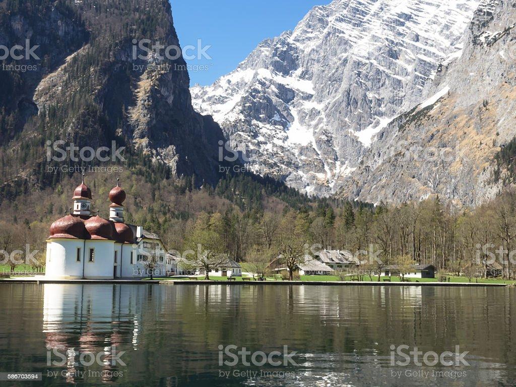 Lake Koenigssee and pilgrimage church Saint Bartholomae, Bavarian Alps, Germany stock photo