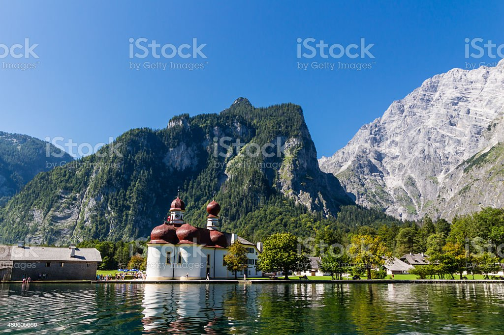 Lake Konigsee in Summer with St. Bartholomew church, Alps, Germany stock photo