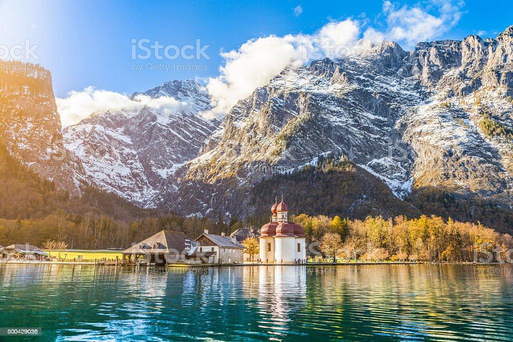 Lake Konigssee with St. Bartholomae pilgrimage church in fall, Bavaria stock photo