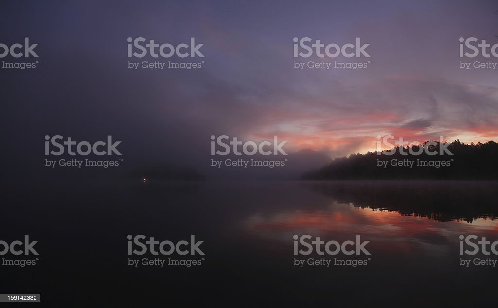 Lake landscape at early morning with sunrise and mist royalty-free stock photo