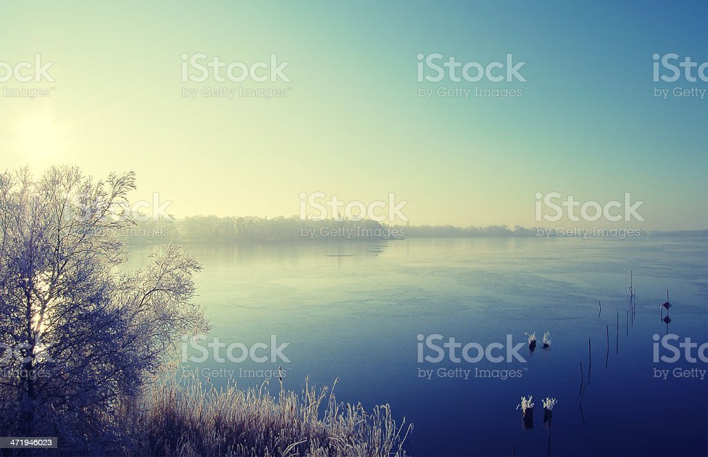 Lake landscape in winter time stock photo